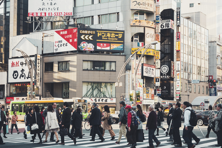 TOKYO, JAPAN - APR 18, 2018 Tokyo street building Business area with People walking city lifestyle Redakční