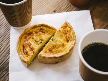 Quiche with hot coffee Cafe table top view Hipster lifestyle Cafe culture