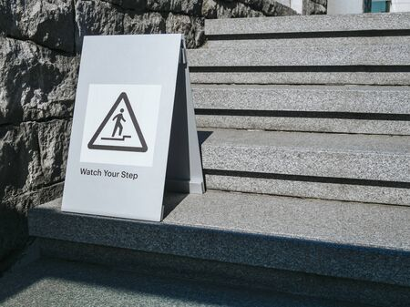 Watch your step Caution sign on stair step Building outdoor signage 写真素材 - 126192754