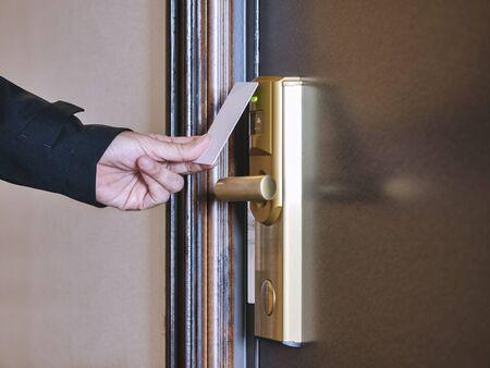 Hand Holding Key card Hotel room access Stock Photo