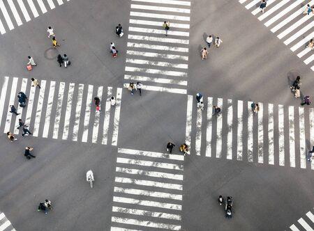 People walking Crossing street Sign Top view Crosswalk in city Business area