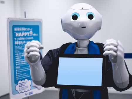 TOKYO, JAPAN - APR 13, 2018 : Pepper Robot Assistant Humanoid with blank screen Fighting Action