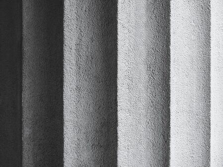 Superficie del fondo strutturata del muro di cemento Dettagli di architettura Colonna