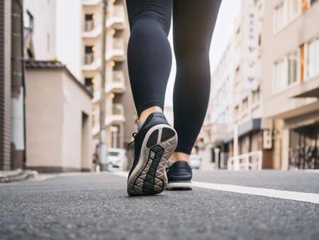 Woman walking on City street morning exercise Travel explorer
