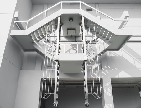 Fire escape stairs ladder Safety exit Architecture details Stock Photo