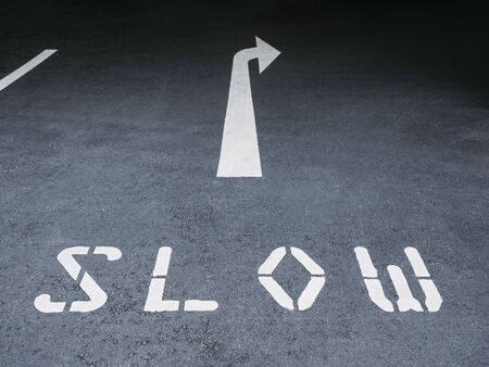 Slow Arrow Road sign direction Street city Traffic signage Reklamní fotografie