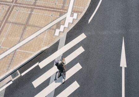 People riding bicycle Crosswalk street Pathway Aerial view Urban city top view