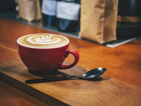 Coffee cup on wooden table Cafe Restaurant Hipster lifestyle Archivio Fotografico - 132210988