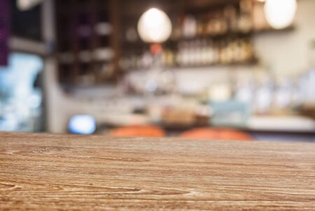 Table top Wooden counter Bar cafe blur background Imagens