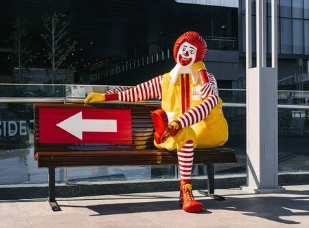 BANGKOK, THAILAND - 10 OCT, 2019 : Mcdonald Mascot Sit on bench Brand Figure shop outdoor