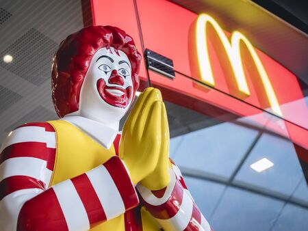 BANGKOK, THAILAND - MAR 14, 2019 : Thai Style Mcdonald Mascot in front of Shop Thailand Ronald McDonald greeting WAI