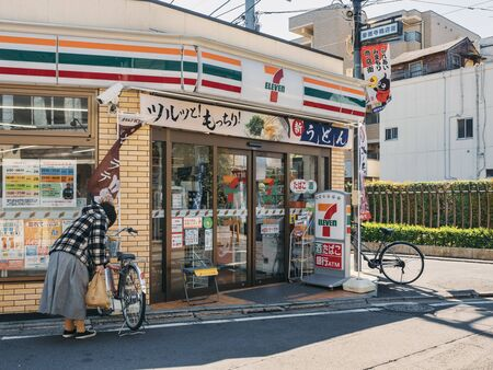 TOKYO, JAPAN - APR 15, 2019 : 7-Eleven convenience store Front Shop with People