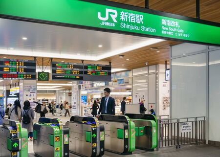 TOKYO, JAPAN - APR 12, 2019 : Japan train Shinjuku station New South gate entrance Business People Tokyo city transportation JR company