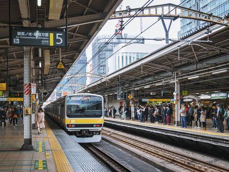 JR Sobu Train on Platform Station Tokyo city Japan Transportation Travel. TOKYO, JAPAN - APR 14, 2019 Redactioneel
