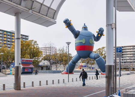 KOBE, JAPAN - FEB 4, 2014 : Tetsujin 28 Giant Robot sculpture and monument symbolize the rebirth of the city of Kobe after the Hanshin Earthquake 1995