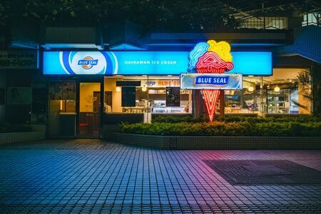 OKINAWA, JAPAN - AUG 31, 2019 : Blue Seal Okinawa ice cream shop famous brand Shop front with Neon sign. Okinawa island Japan