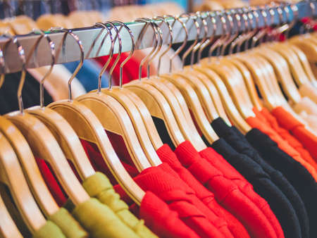 Clothing on Hangers Fashion retail Display Shop Colourful T shirt Business concept