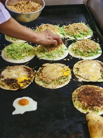 Street food Japan Chef cooking Okonomiyaki on hot plate