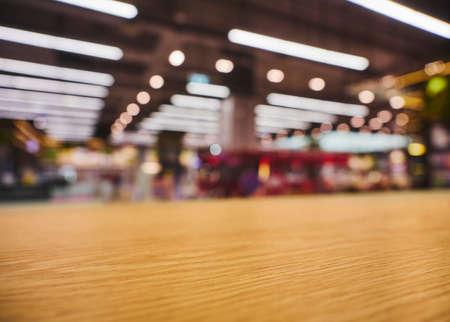 Table top counter with neon lighting Retail shop interior blur background Standard-Bild