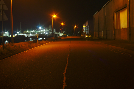 night street without people in Bremen port no workers no ships and vessels