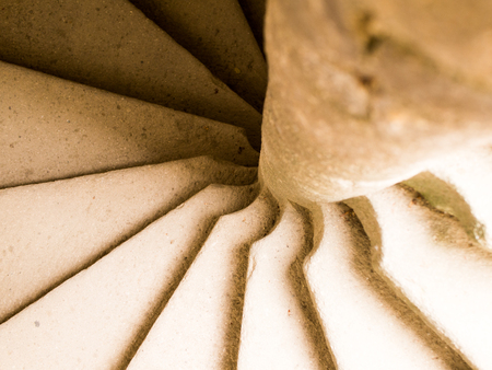 Spiral sandstone staircase detail in a tower.