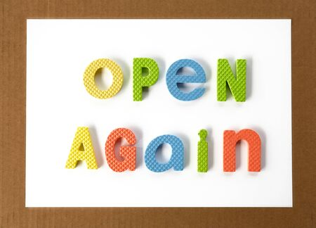 Open again sign. Were open again after quarantine.