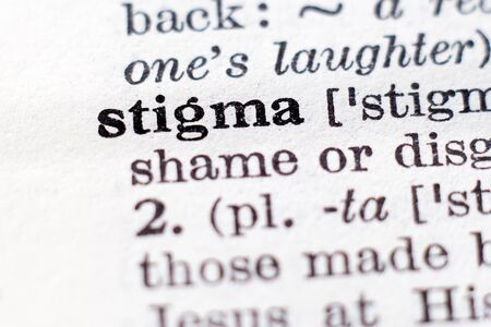 Dictionary definition of word Stigma, selective focus.