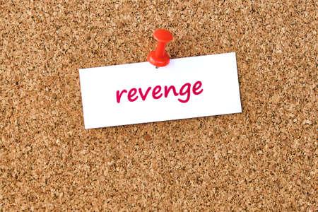 Revenge. Word written on a piece of paper or note, cork board background. Standard-Bild