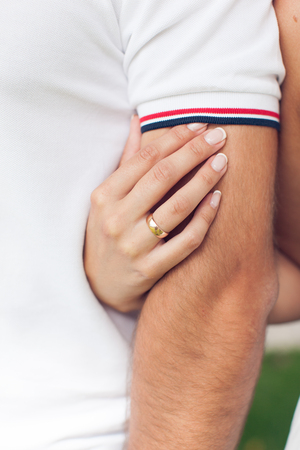 Girl with a ring on the finger hugs guy Stock Photo