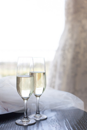 cutglass: Two glasses of champagne near the wedding veil