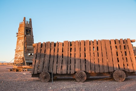 Battering ram and siege tower in a desert at evening Stock Photo