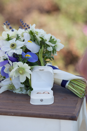 Wedding rings and white blue flower bouquet stock photo picture and stock photo wedding rings and white blue flower bouquet mightylinksfo