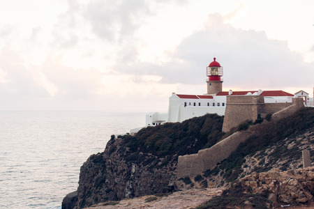 region of algarve: Sunset and a view of the lighthouse at Cape St. Vincent. Portugal. Region Algarve