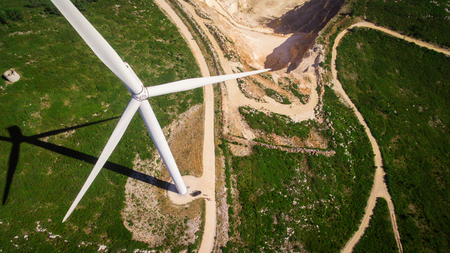 windpower: Car under windmills generator on the field, Portugal