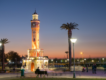 Night place with clocktower and palms in Izmir.