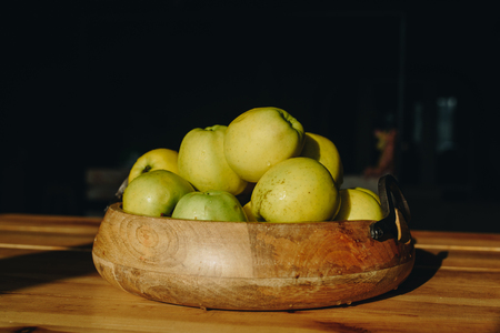 healty: Healthy green food with apples on wood plates desk background mock up. Sunset time.