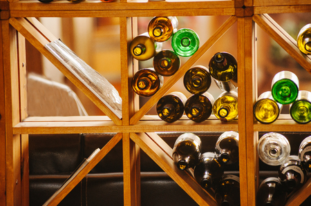 Wine cabinet with bottles and glasses. Daylight