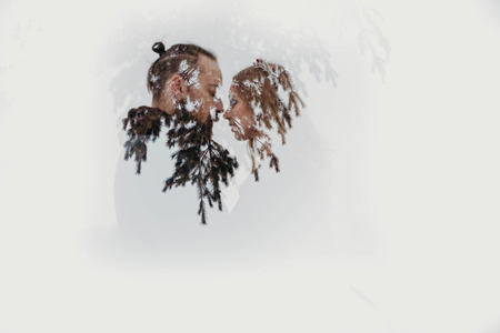 Art photo from camera. Double exposure of couple in love and tree of forest. Valentine art concept. 免版税图像