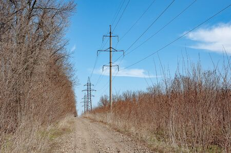 Electricity transmission power lines. The high voltage towers.