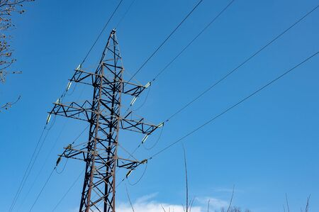 Electricity transmission power lines. The high voltage tower.