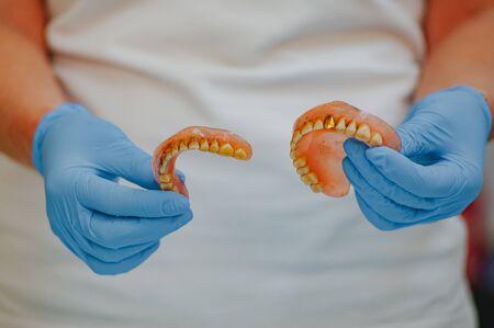 Broken acrylic denture. Dental phantom. Selective focus photo.