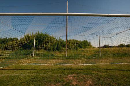 Football gate and football net. Soccer concept. Village stadium. Фото со стока