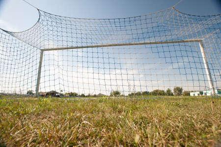 Football gate and football net. Soccer concept. Village stadium.