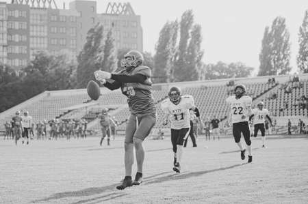 KHARKIV, UKRAINE - SEPTEMBER 26, 2020: American football players in action during match of Ukrainian Super League Atlantes Kharkiv vs. Slavs Kyiv