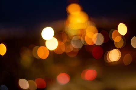 Blured lighhts bokeh for background from walking street