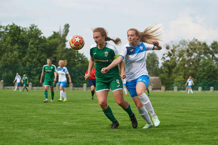 KHARKIV, UKRAINE - MAY 29, 2021: Woman football match Zhilstroi-2 vs. Karpaty. Public events are allowed. Europe match of football during CV pandemic. Publikacyjne