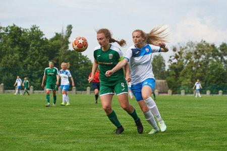 KHARKIV, UKRAINE - MAY 29, 2021: Woman football match Zhilstroi-2 vs. Karpaty. Public events are allowed. Europe match of football during CV pandemic. Sajtókép