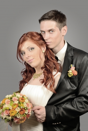 Close up of a nice young wedding couple photo
