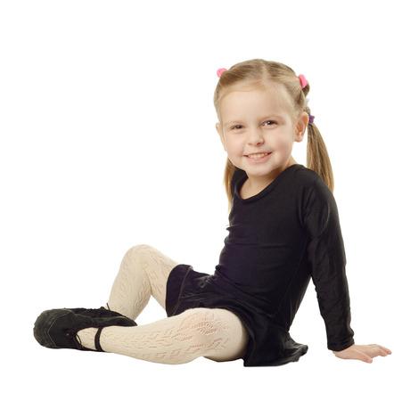 Little Girl dancer sits on White Background