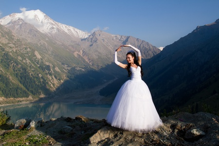 romantic girl in a wedding dress on a white nature Stock Photo - 10300150